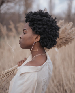 Afro hair style, off shoulder shirts